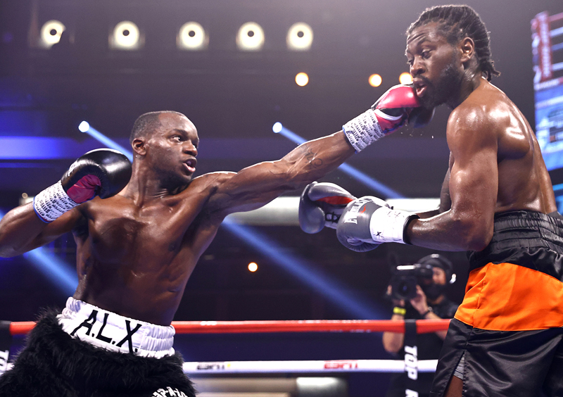 Troy Isley (left) goes to the Tokyo Olympics next month off a TKO win over LaQuan Evans. Photo by Mikey Williams/Top Rank Inc via Getty Images